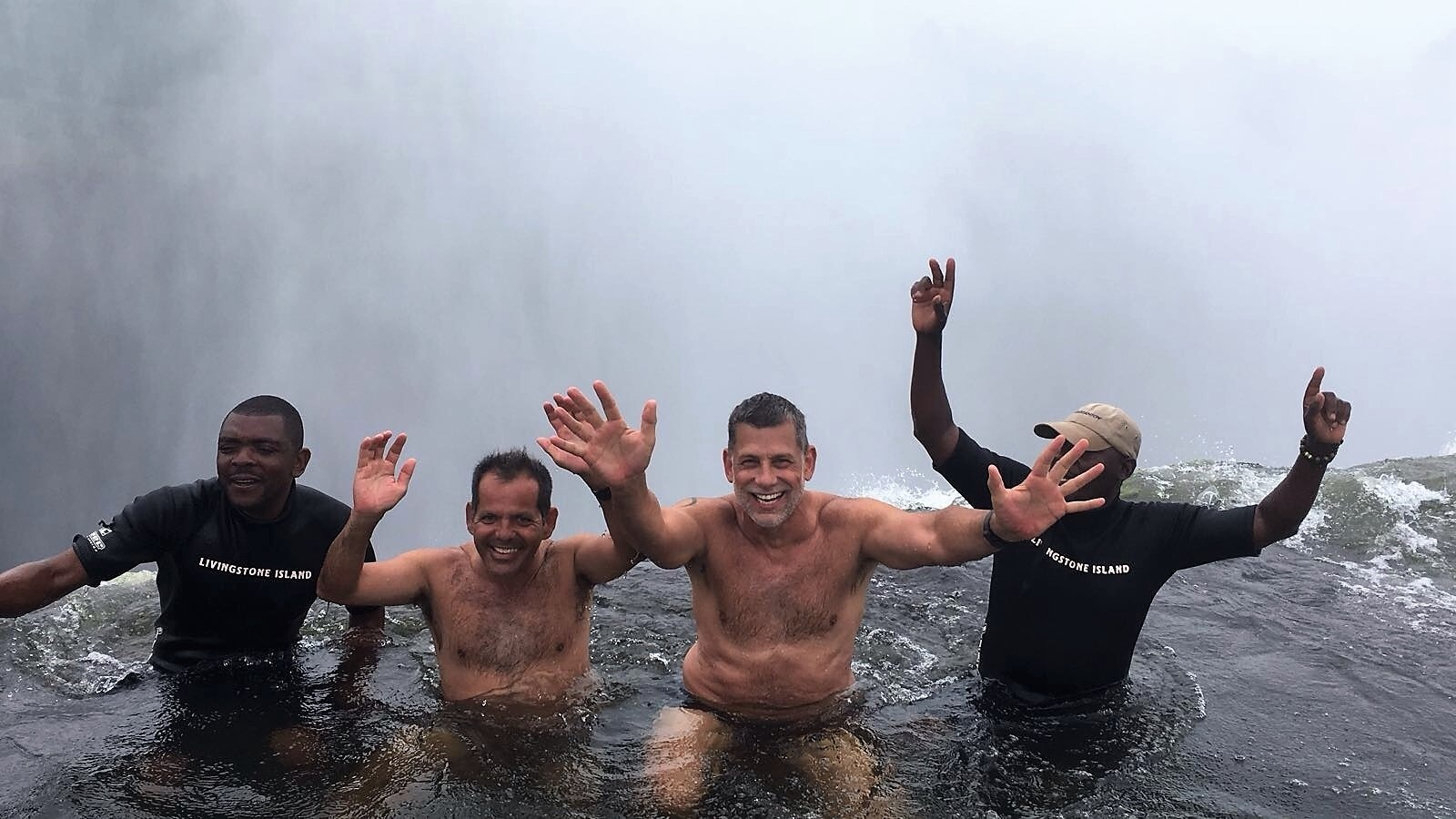 Our Founder Mitch Swimming in Victoria Falls