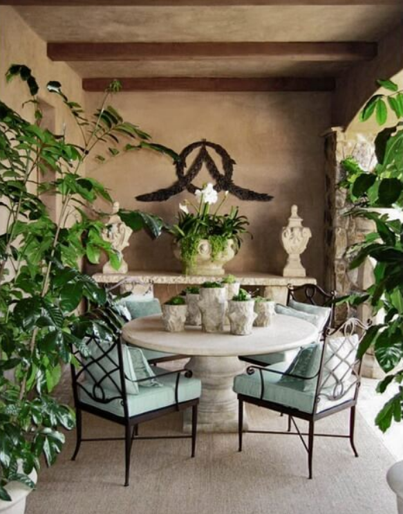 Design by Barbara Grigsby featuring a Stone Yard custom table and console