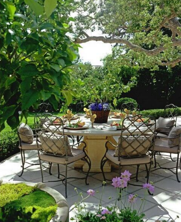 Design by Barbara Grigsby featuring a custom Stone Yard table