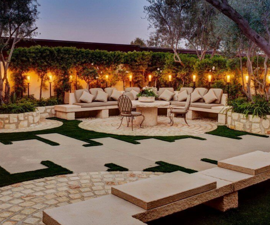 Design by Barbara Grigsby featuring custom Stone Yard seating and table