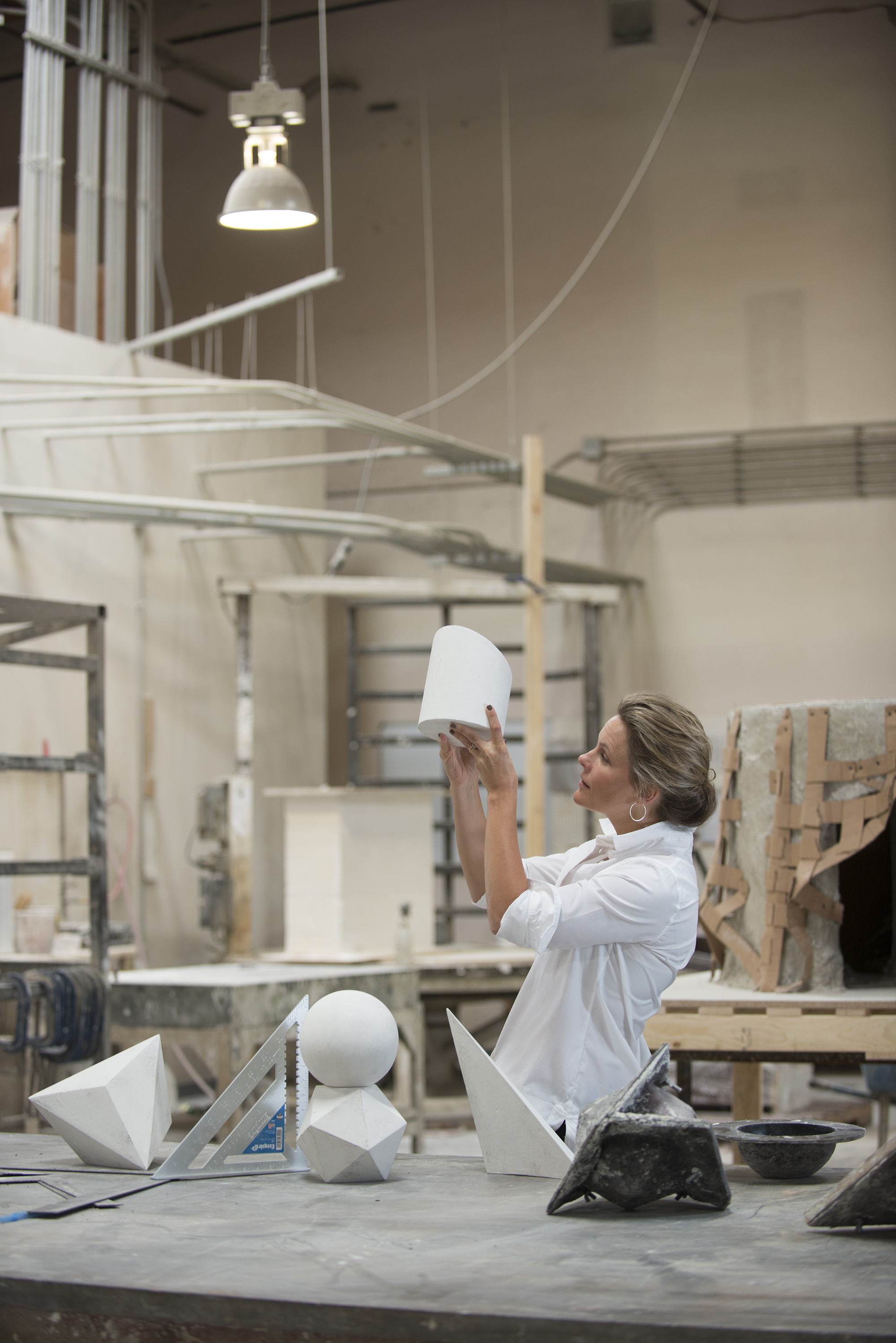 Amy Meier working on her new line of geometric sculptures for Stone Yard
